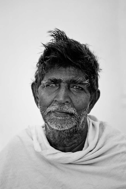 A b&W portrait photograph, made in Chennai, India that conveys the worry and wisdom associated with old age