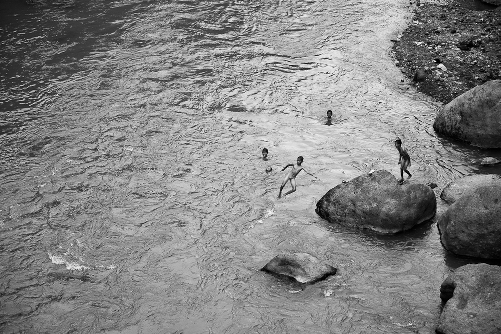 kids bathing in river, high country, Bali