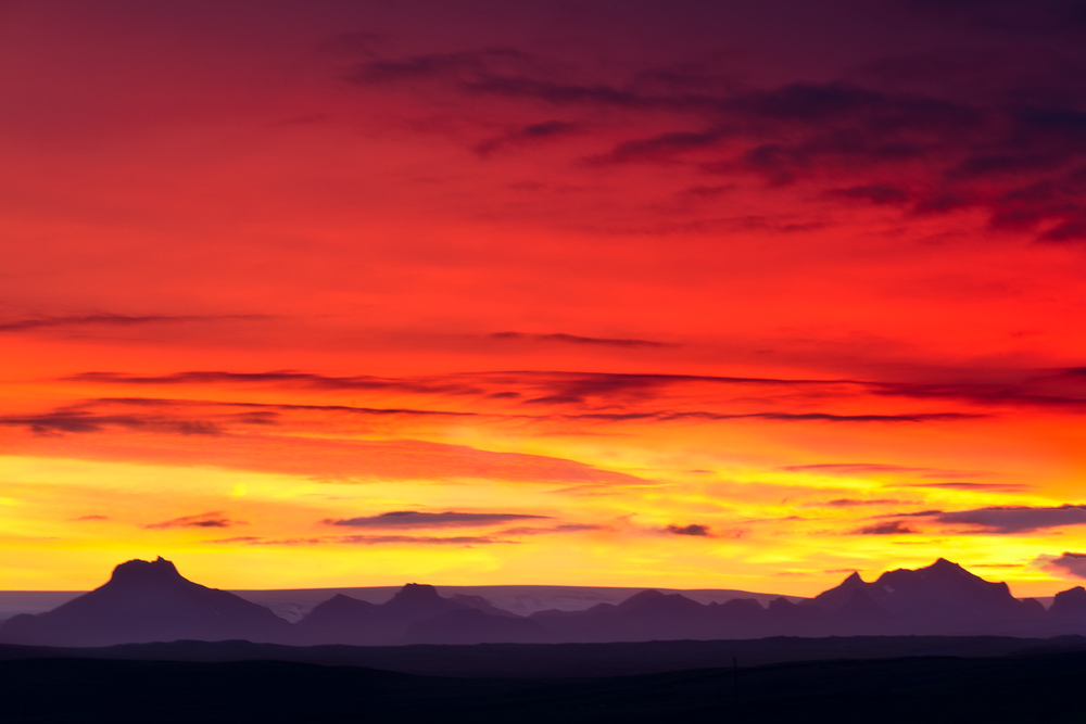 A sensational sunset over a distant mountain range, just off highway 1, in southern Iceland