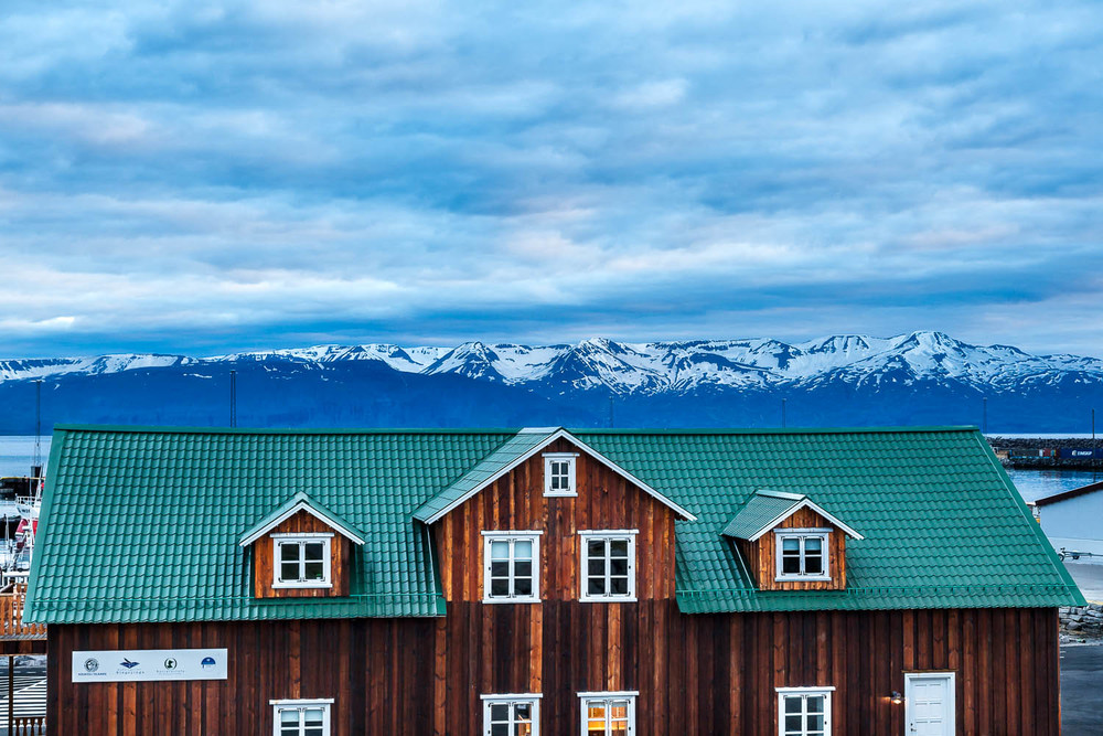 Tourist building and distant mountains, Húsavík, Iceland Canon 5D Mark II camera and Canon 24-105mm f4 L series lens @ 55mm. Exposure: 1/15 second @ f8 ISO 400.