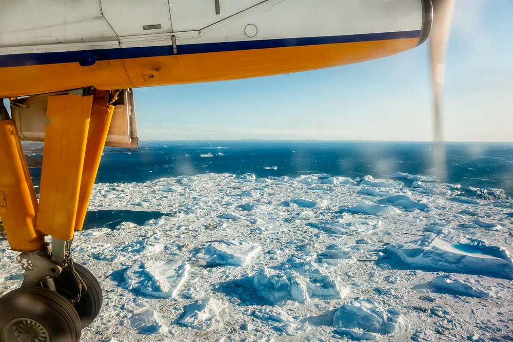 The wild beauty of    Greenland    seen through my plane window just before landing in    Ilulissat, Greenland   .