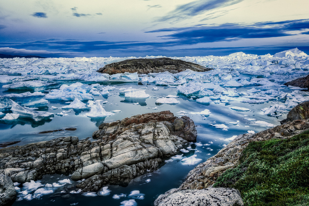 A stunning view of rock and ice on the edge of the Ilulissat Icefjord, Greenland.