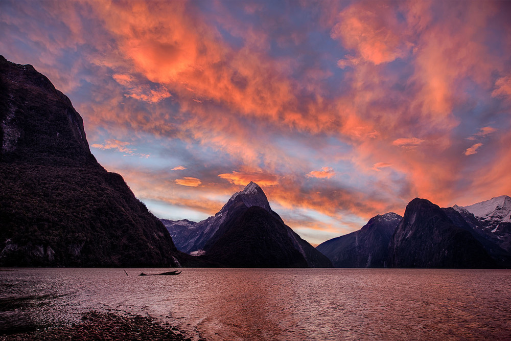 Afterglow following a spectacular sunset above Mitre Peak on Milford Sound in Otago, New Zealand.