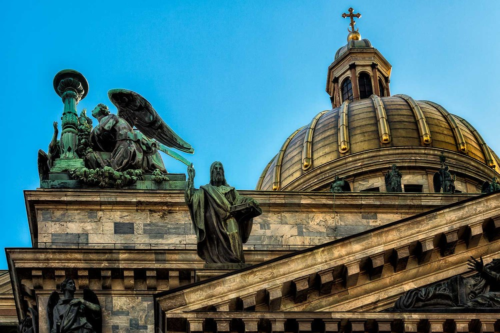 A dramatic view of the dome and statues at St. Isaac's Cathedral, St. Petersburg, Russia.