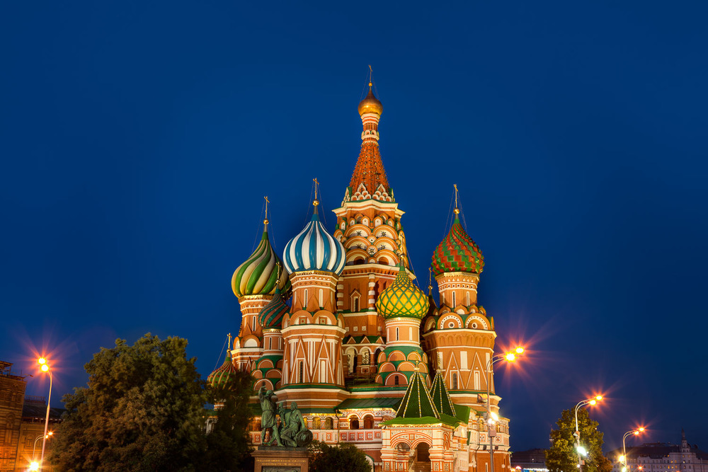 St. Basils Cathedral, glowing against a deep blue night sky Red Square, Moscow