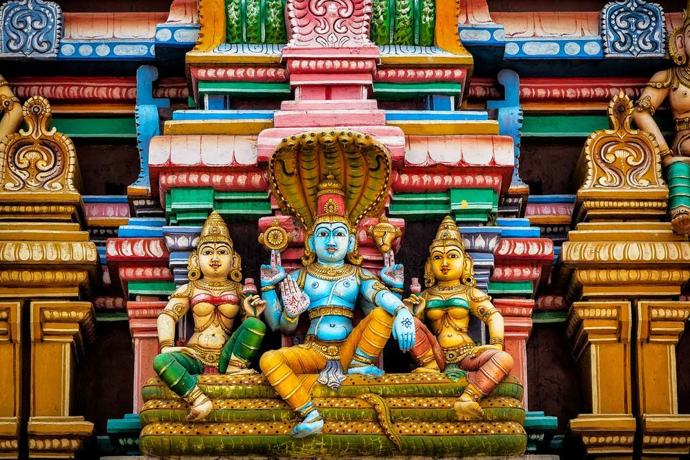 Garish colors reign supreme in this close up study of Hindu deities on the front of a shrine in Chennai, India.