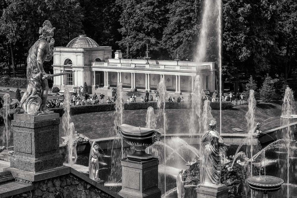 A black and white image showing a rear view of the Grand Cascade at Peterhof Palace near St. Petersburg, Russia.