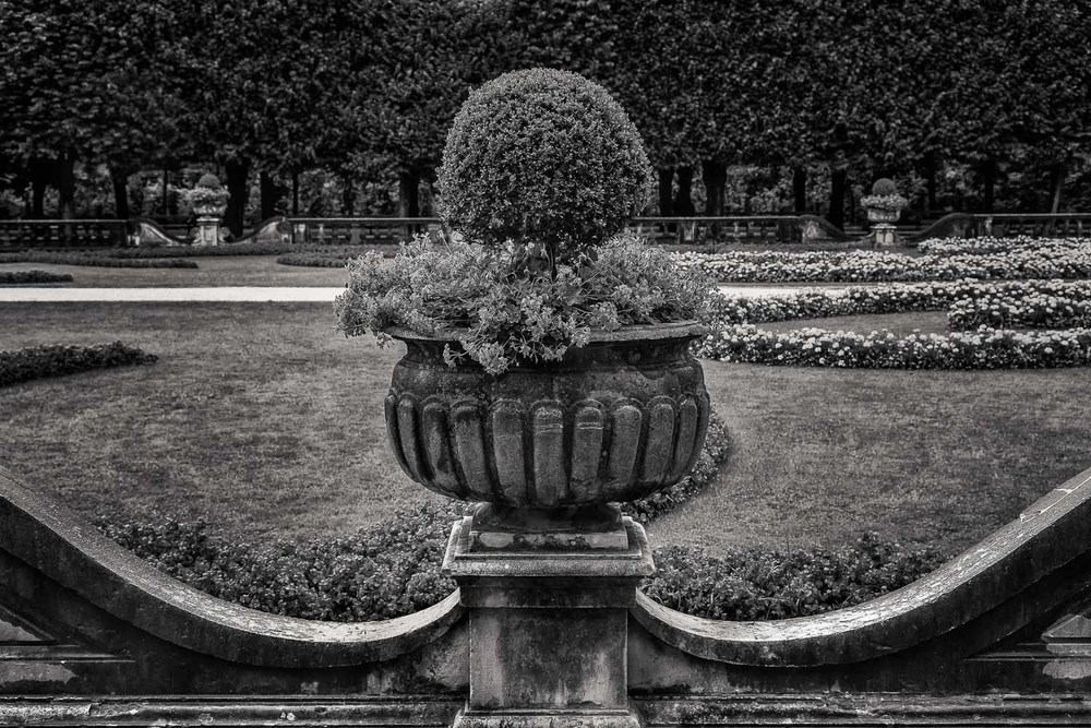 The black and white photo made in the Mirabell Gardens in beautiful Salzburg, Austria is a great example of how to improve composition through symmetry.