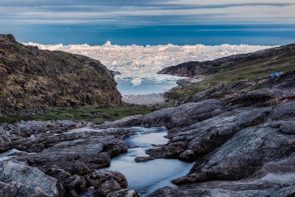 A view down onto a small part of the massive Ilulissat Icefjord while on a late night hike under the midnight sun near the town of Ilulissat, Greenland.