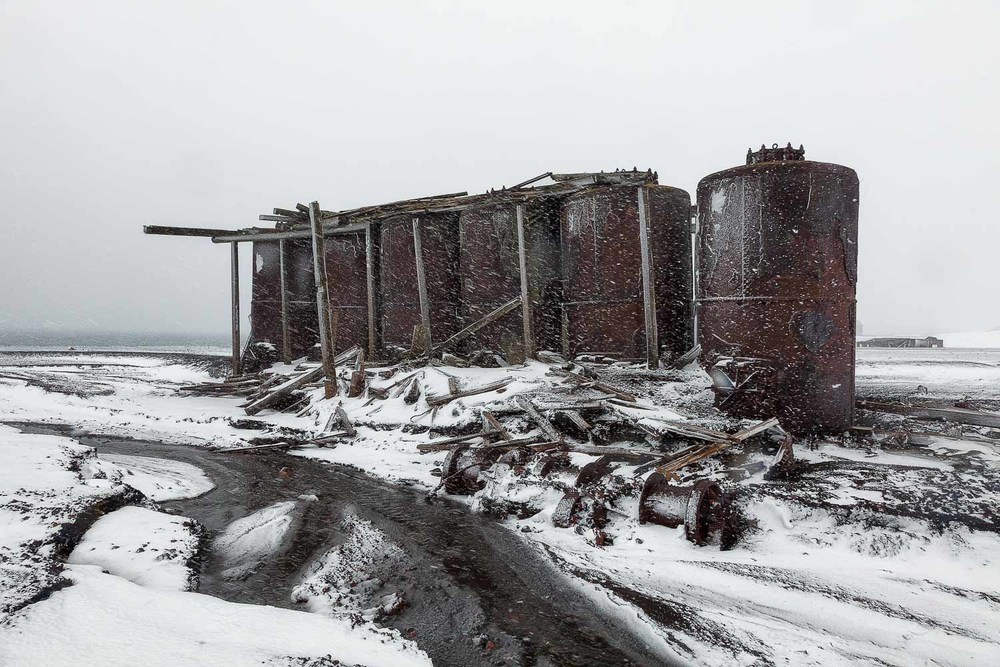A group of old rusted oil drums at Port Foster on Deception Island, Antarctica