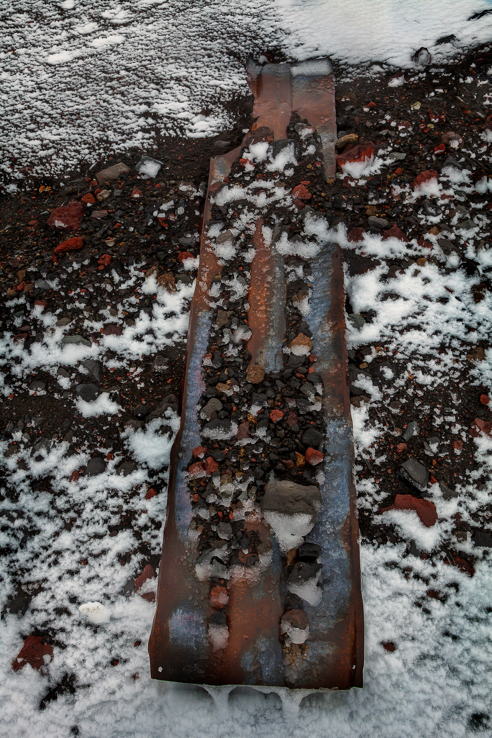 A detail, photographed during a snowstorm, of rusted metal at Port Foster near Whalers Bay on Deception Island.