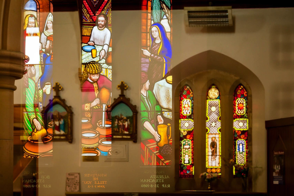 Reflections of stained glass windows make for a surreal image in St. Mary's Catholic Church, Hamilton, Australia.