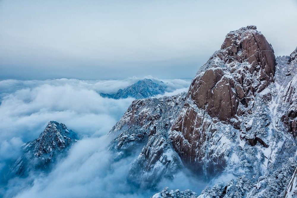 A sublime view, early in the morning, above the clouds on  Huangshan  (i.e., Yellow Mountain),  China .