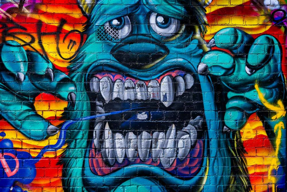 A highly detailed and vividly colored graffiti monster in Hosier Lane, Melbourne.