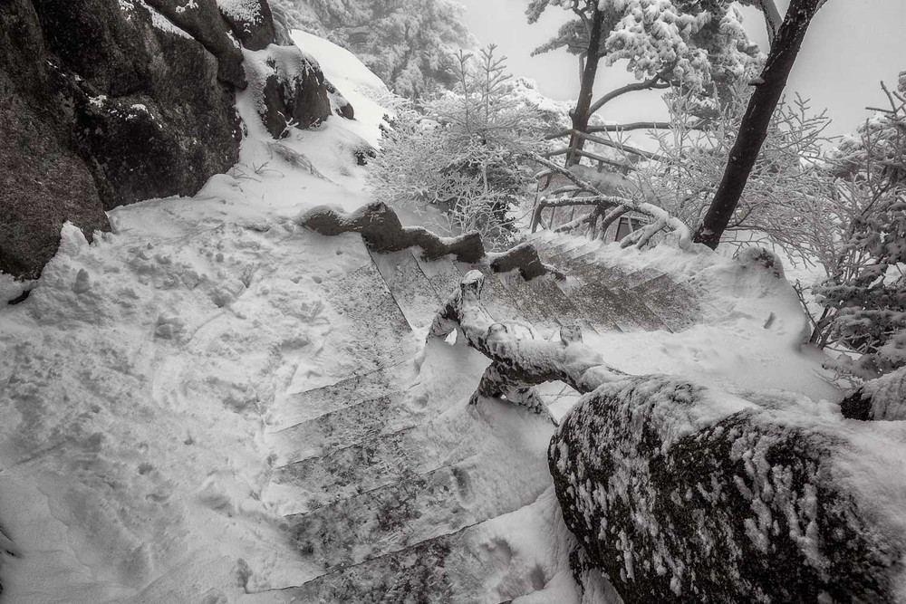 A winding staircase illustrates the need to take care along certain sections of the path during  winter on Hughashan  (i.e., Yellow Mountain),  China .