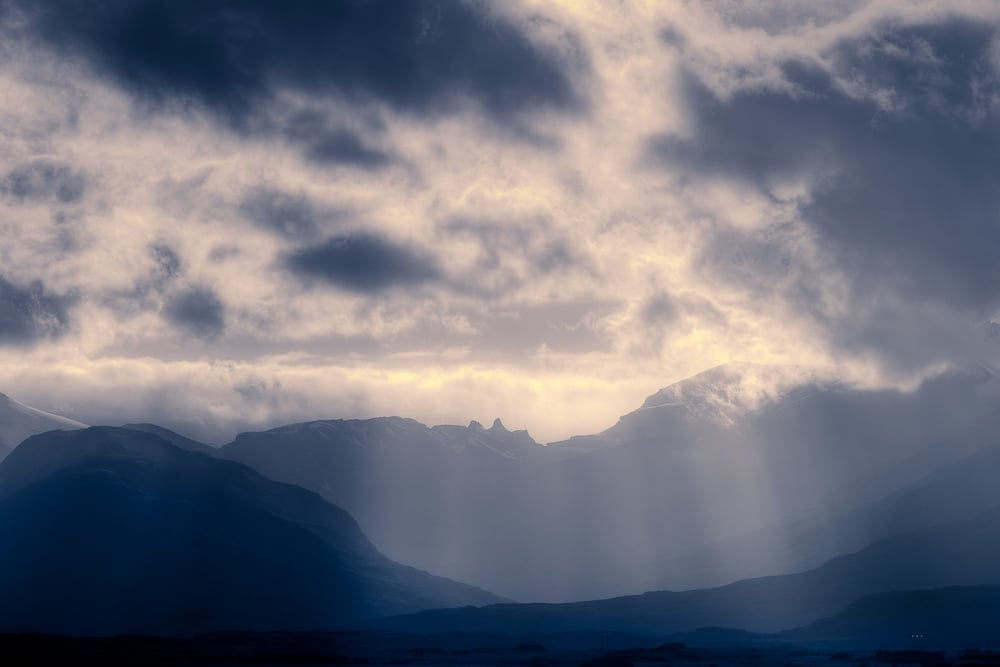Magnificent 'God Rays' illuminate the landscape in the Highlands region of Central Iceland.