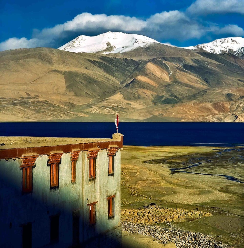 A beautiful  Buddhist monastery  in a spectacular landscape on the shores of  Pangong Tso ,  Ladakh, India