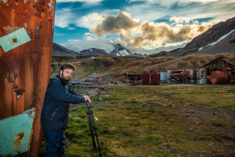 An environmental portrait of photographer, Craig Goldsmith, at Grytviken on South Georgia Island.