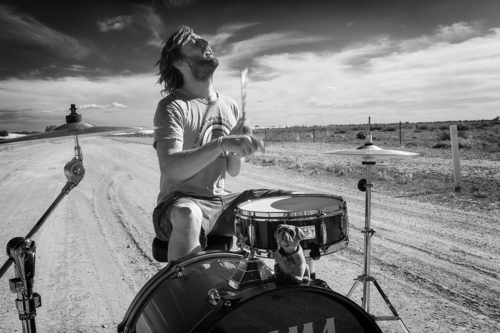 Crew member,  Mark Blanch , banging out a beat during a break from the filming of  Summer Coda  near the  Perry Sandhills  in south west  NSW .