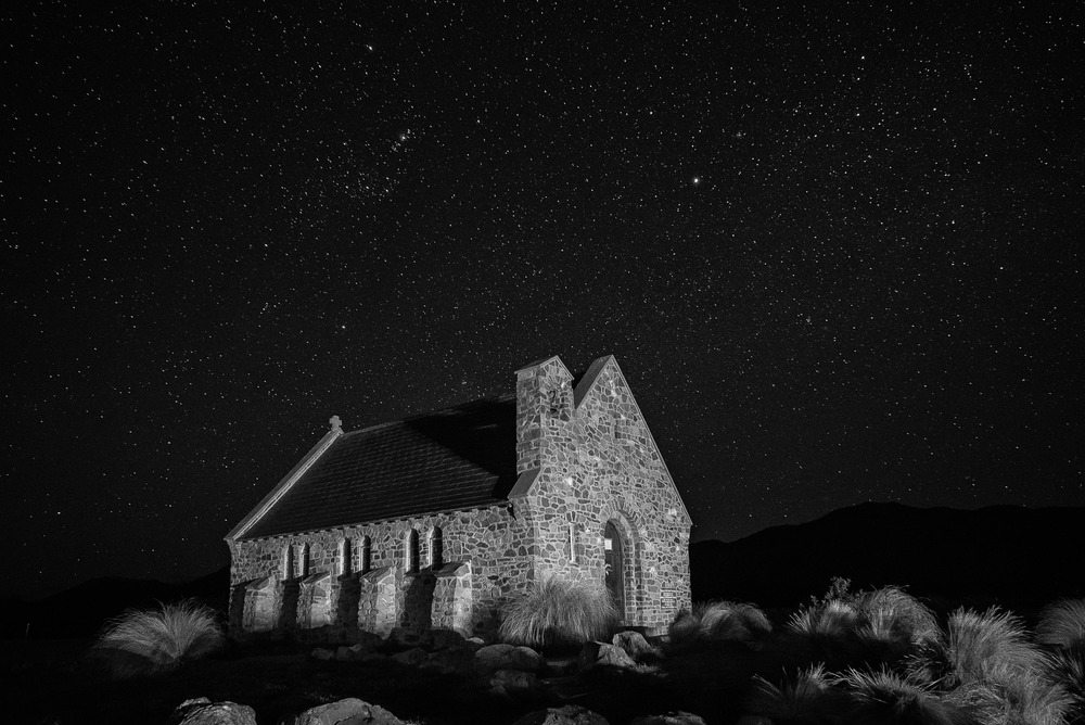 A black and white night photogaph of the lovely    Church Of The Good Shepherd    in    Lake Tekapo   ,    New Zealand   .