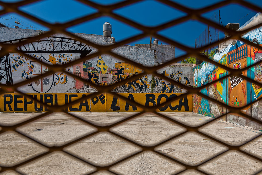 Looking through the wire at colorful walls in La Boca, Buenos Aires, Argentina.