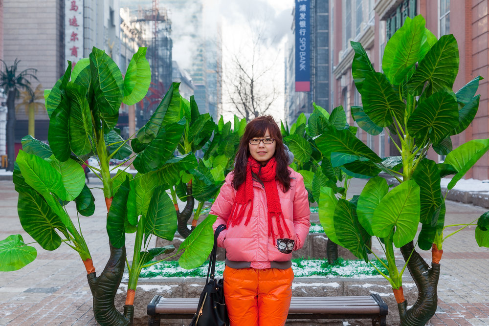 A colorful portrait of a young woman in Harbin in north east China on a cold winter's day.