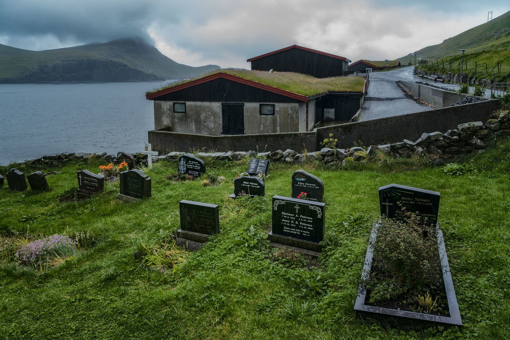 Rain falls over the cemetery in the village of Bøur on Vagar in the Faroe Islands.