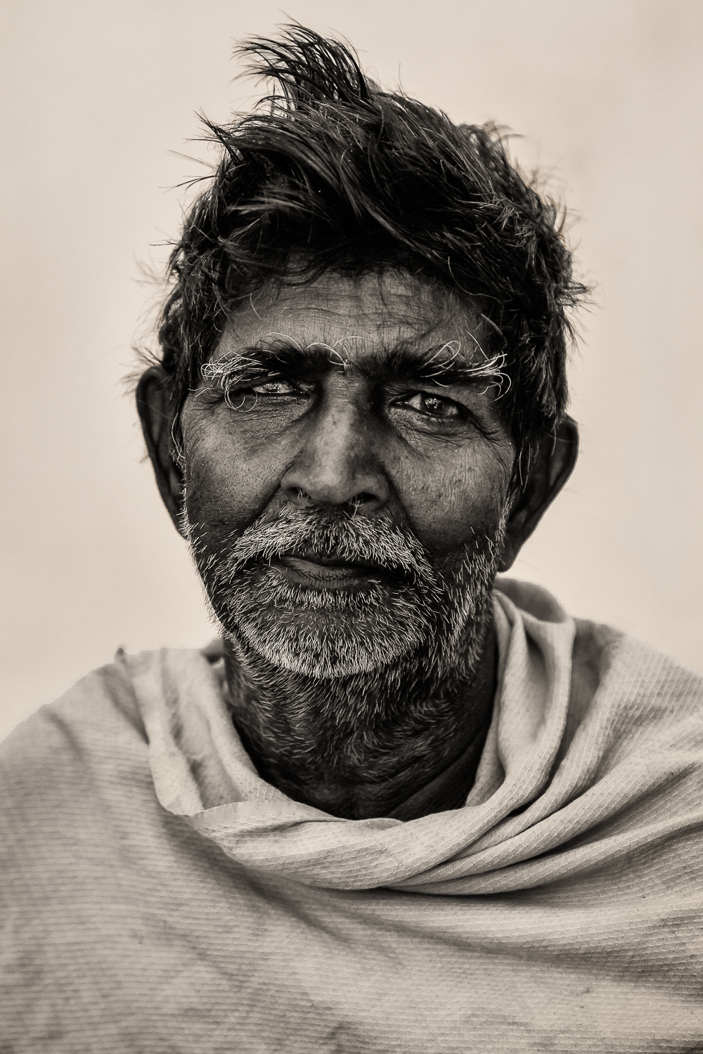 The look of    a life very much lived    in the eyes of this dignified man in    Chennai, India