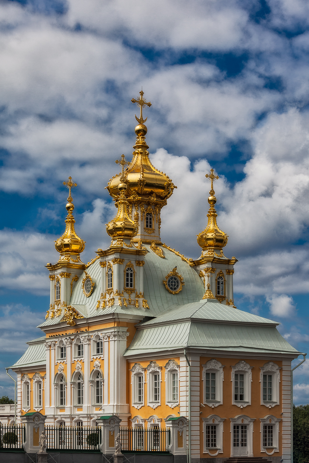Spectacular domes   , gleaming on a summer's day, set off a magnificent building at    Peterhof Summer Palace    near    St. Petersburg, Russia   .