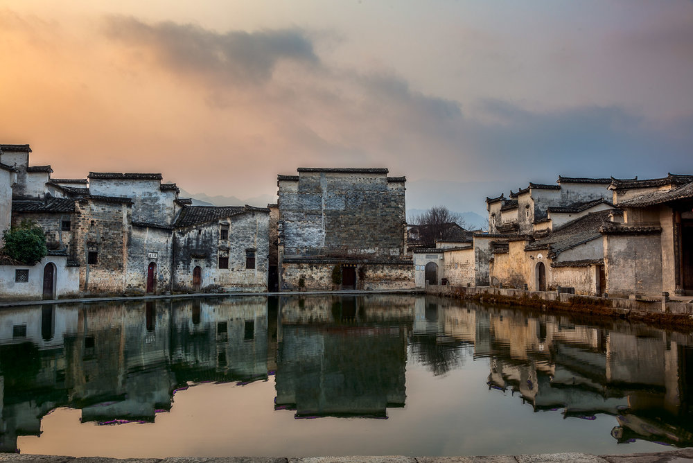 The pond surrounded by houses in the centre of  the idyllic village of Hongcun  in Anhui Province,  China .