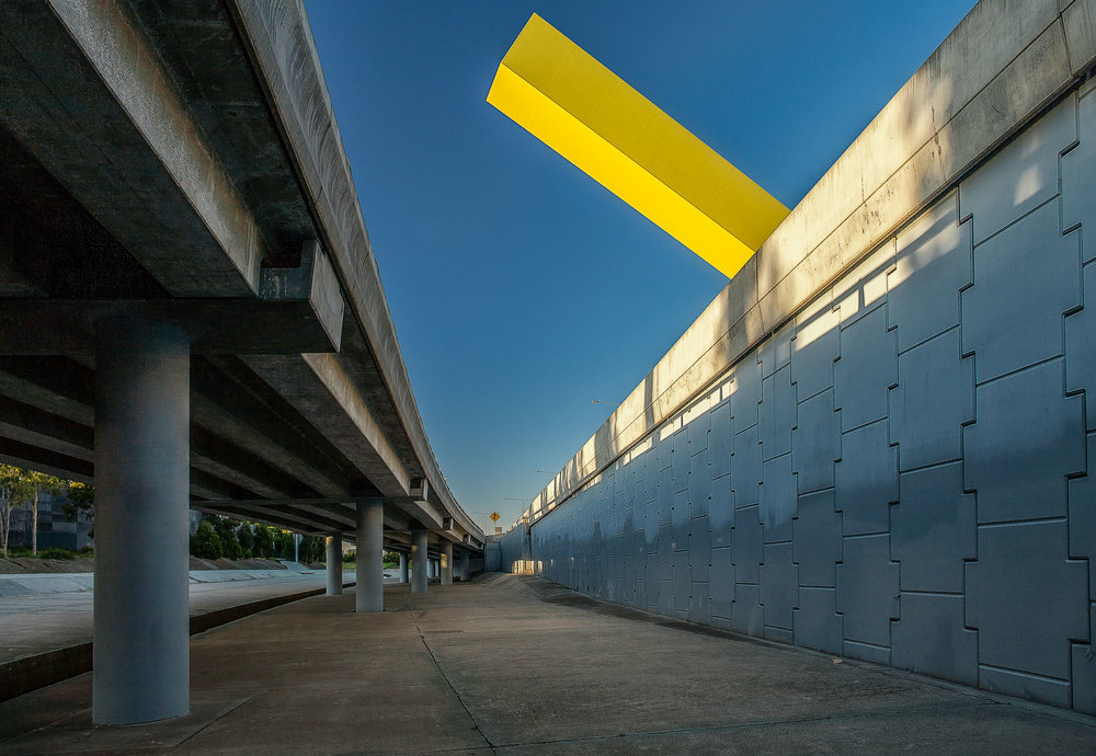 A vivid yellow structure makes for a powerful visual statement to folks traveling along the Tullamarine Freeway in Melbourne, Australia. This image is based around the notion of complimentary colors.