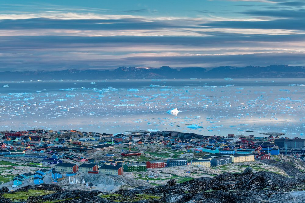 A view over the town of  Ilulissat  out over  Disko Bay  towards distant mountains,  Greenland .