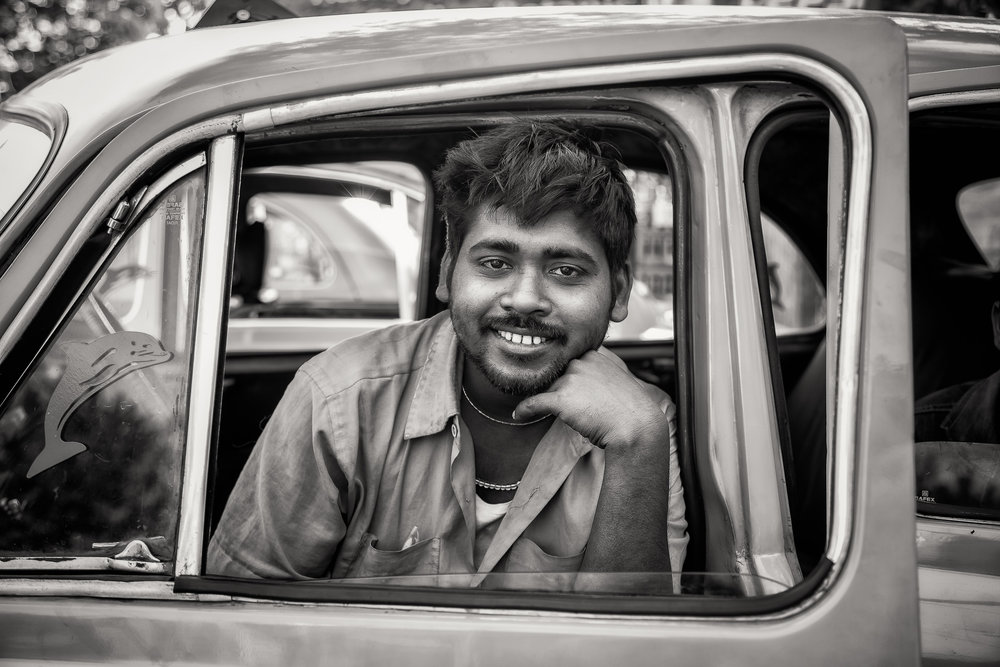 Portrait  of a  taxi driver  at rest in the back streets of  Kolkata, India