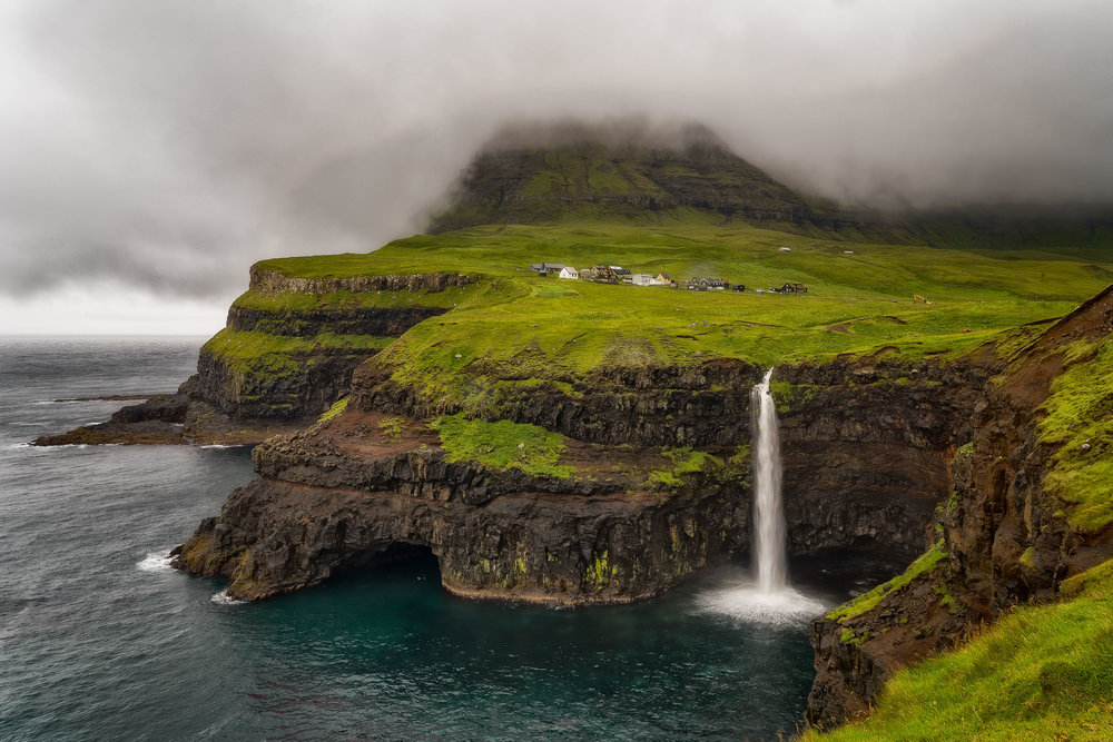The spectacular Gásadalur Waterfall on the edges of the sea on the island of Vágar on the Faroe Islands.