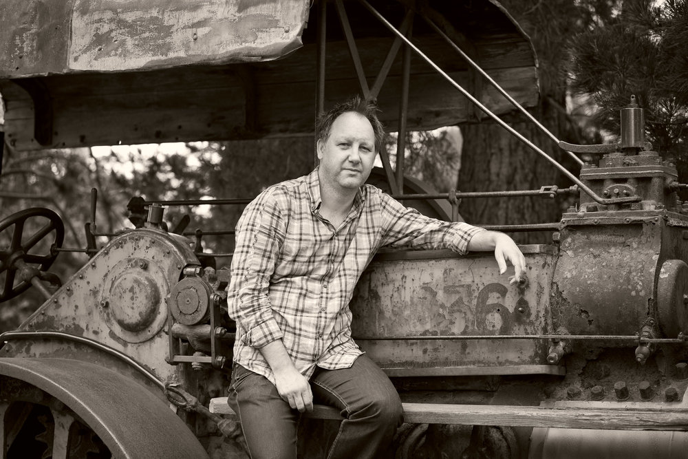 A sepia like portrait of Dale, seated on old machinery, on the outskirts of Melbourne, Australia.