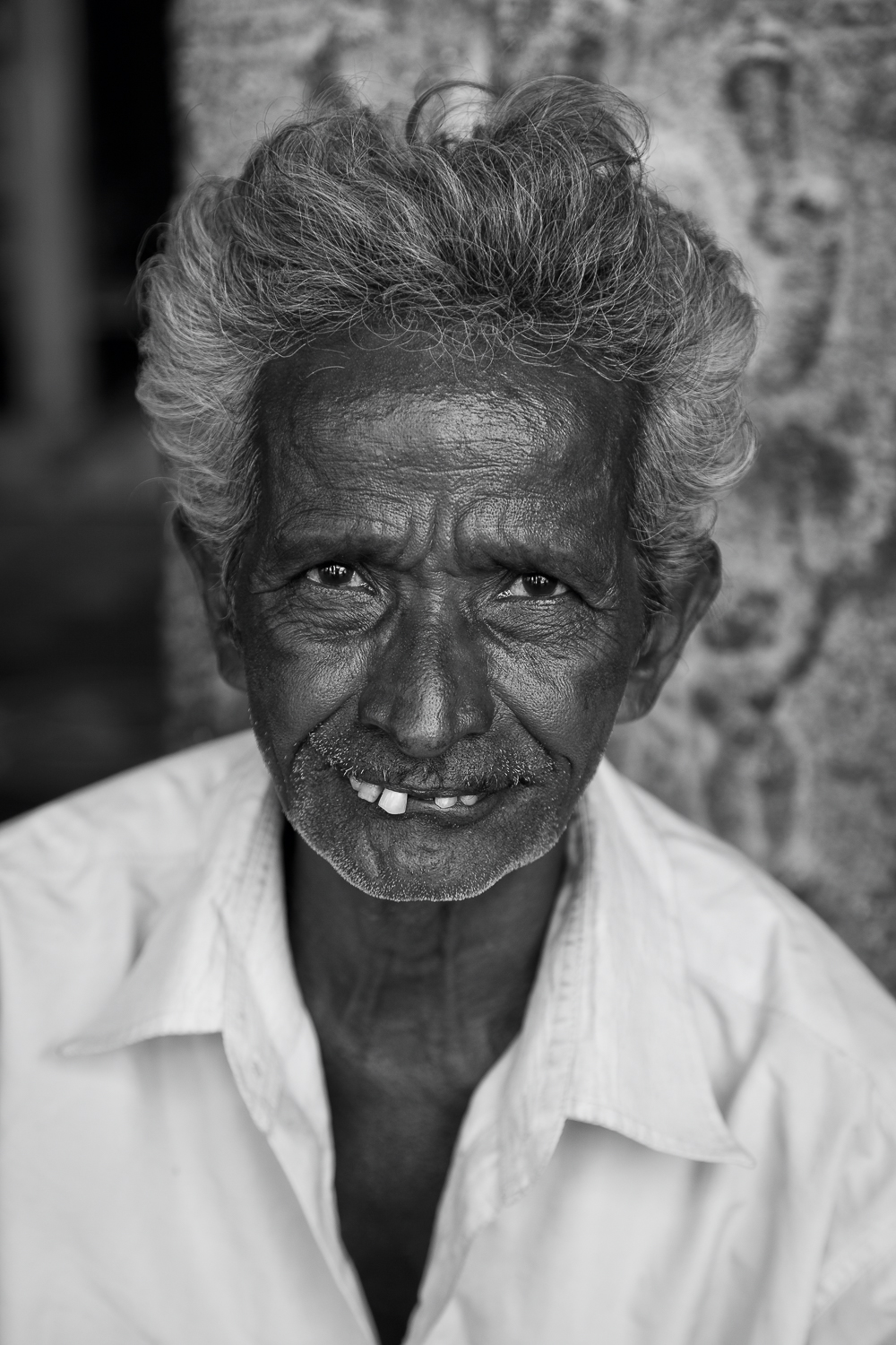 Black and white    portrait of a man    visiting the    Kali temple    in    Chennai, India   .