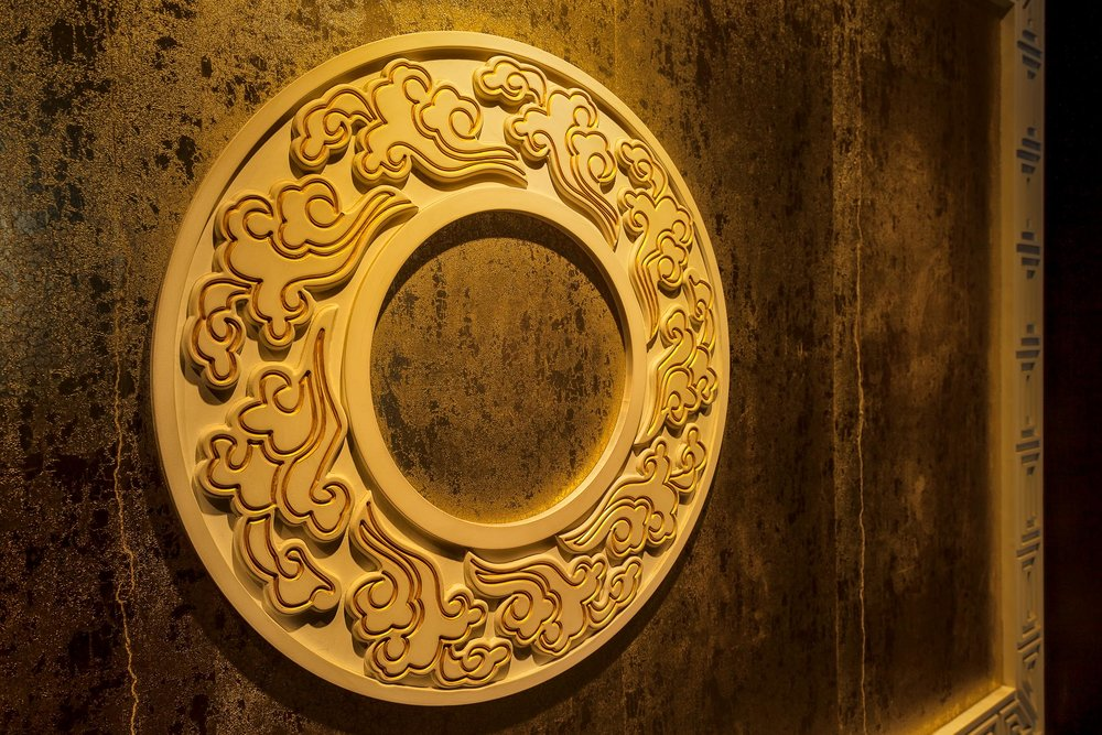 A beautifully ornate yellow disc on display at the Temple Of Heaven in Beijing, China.