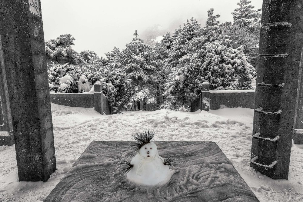 A tiny snowman under a shelter on Huangshan (i.e., Yellow Mountain), China.