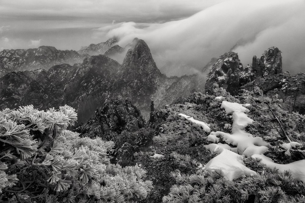 Clearing mist reveals a spectacular landscape on Huangshan (i.e., Yellow Mountain) in China.