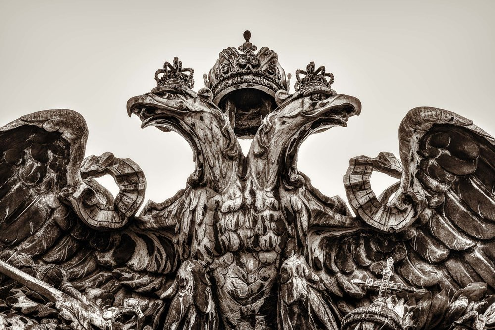 A highly detailed  sculpture of two eagles and a royal crown  in  Vienna, Austria