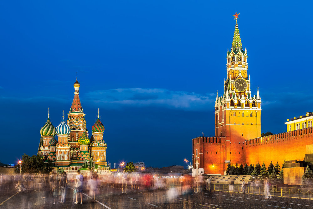 The crowd moves silently through the spectacular Red Square in Moscow, Russia on a balmy summer evening flanked by the magnificence of St. Basil's Cathedral and the Kremlin.