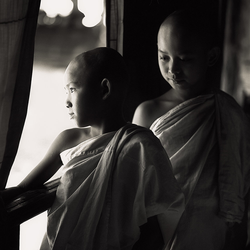 Two young    novice monks    standing on a verandah in a    monastry in Myanmar    (i.e., Burma).