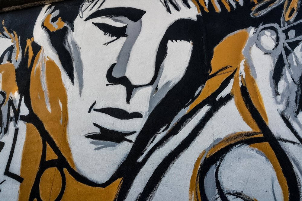 This  portrait  is a wonderful example of  Street Art  at the  East Side Gallery  in  Berlin, Germany .