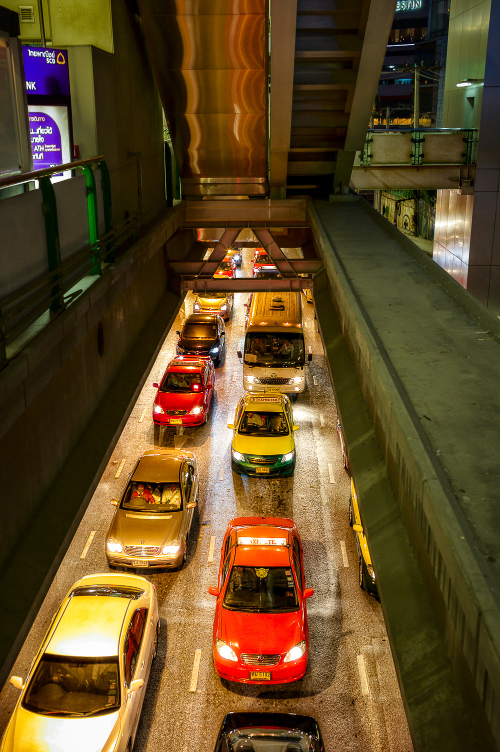 Traffic congestion  on the streets of  Sukhumvit  at night in  Bangkok, Thailand .