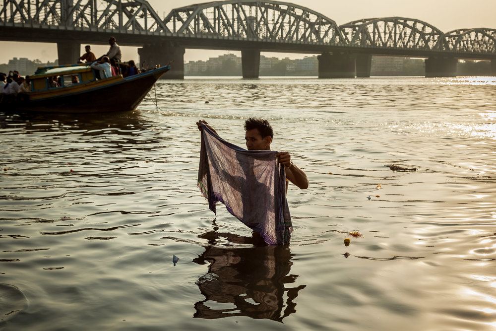 Pilgrim in the Hooghly River at Sunset, Kolkata, India