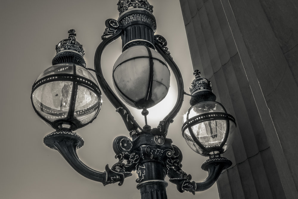An ornate street lamp near the front entrance to Parliament House in Melbourne, Australia.