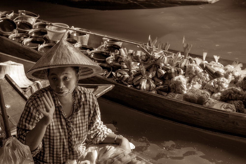 A woman selling her produce from a canoe at the Floating Markets near Bangkok in Thailand.
