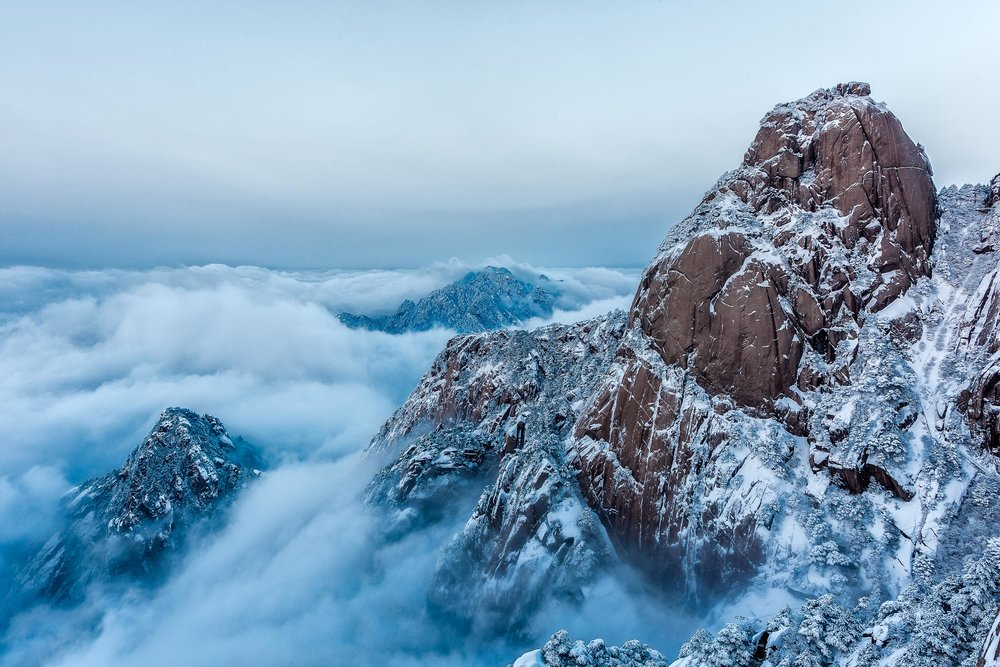 A sublime view, early in the morning, above the clouds on Huangshan (i.e., Yellow Mountain), China.