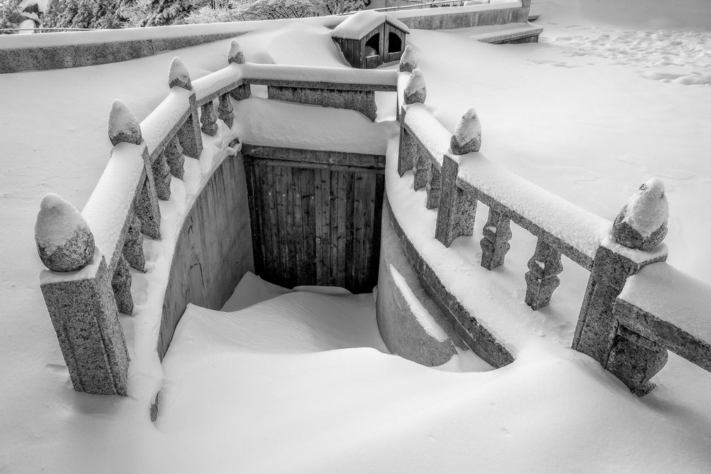 A back door entrance surrounded by snow on Huangshan (i.e., Yellow Mountain) in China.
