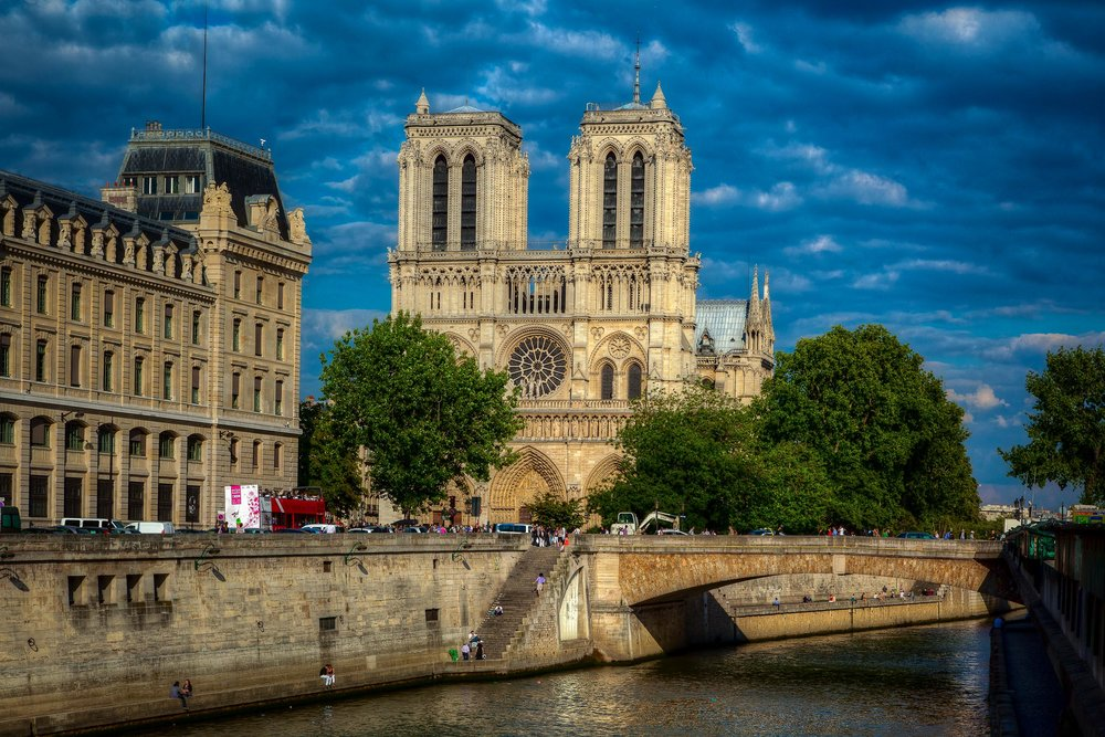 A sunny day view of Notre Dame Cathedral and the River Seine in Paris, France.